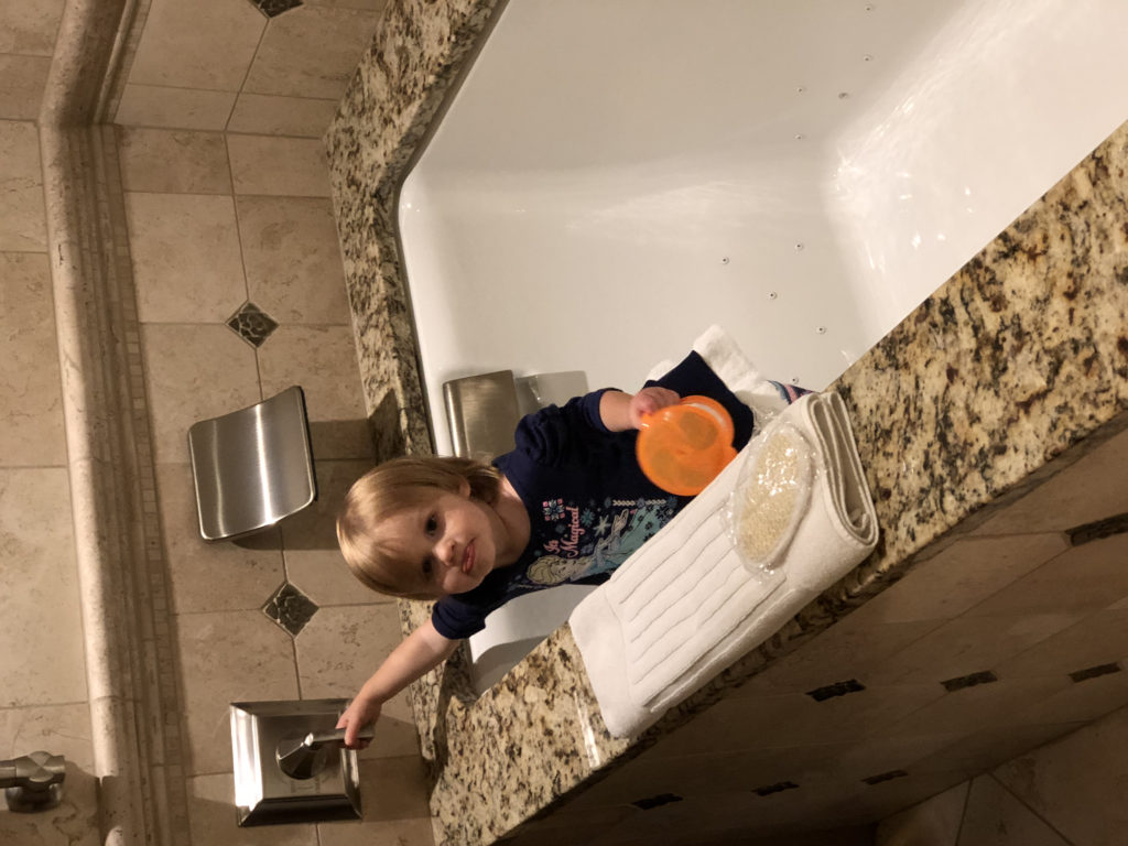 Toddler checking out the bathtub at the American Club Hotel | days trips near Chicago