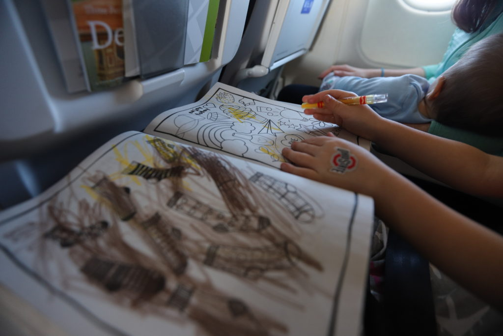 Coloring book on airplane tray table