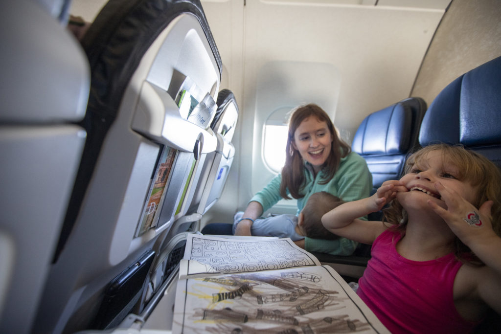 Family having fun and coloring on an airplane