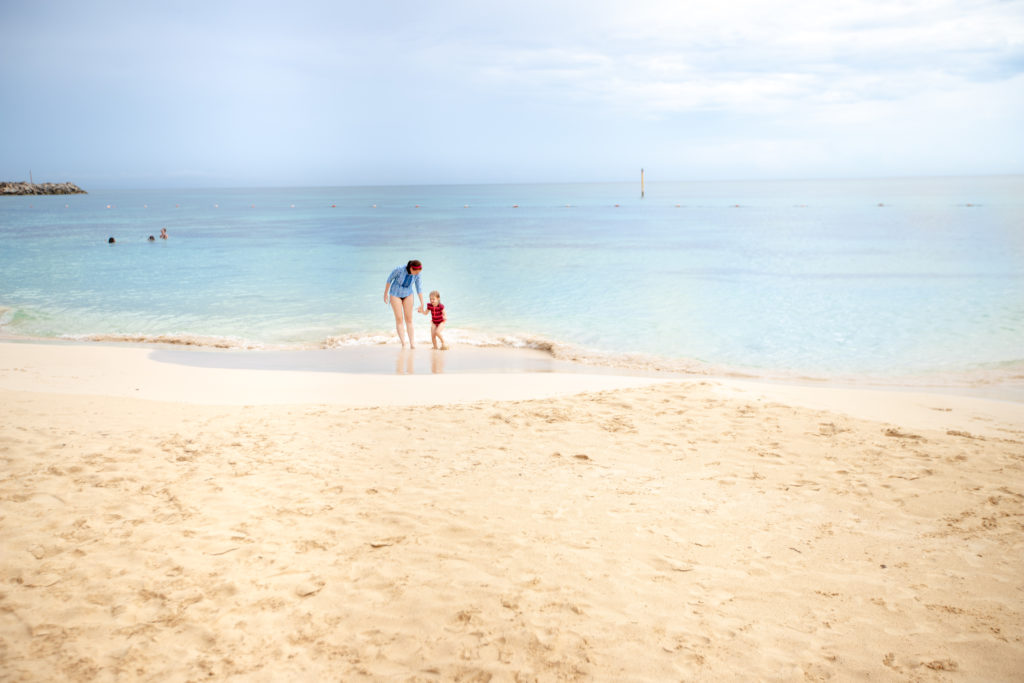 Mom and daughter swimming on the beach at the Now Jade Resort in Puerto Morelos, Mexico