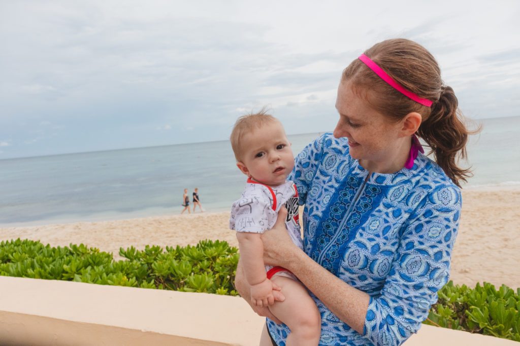Mom with 6 month old son on the beach at the Now Jade Riviera Resort