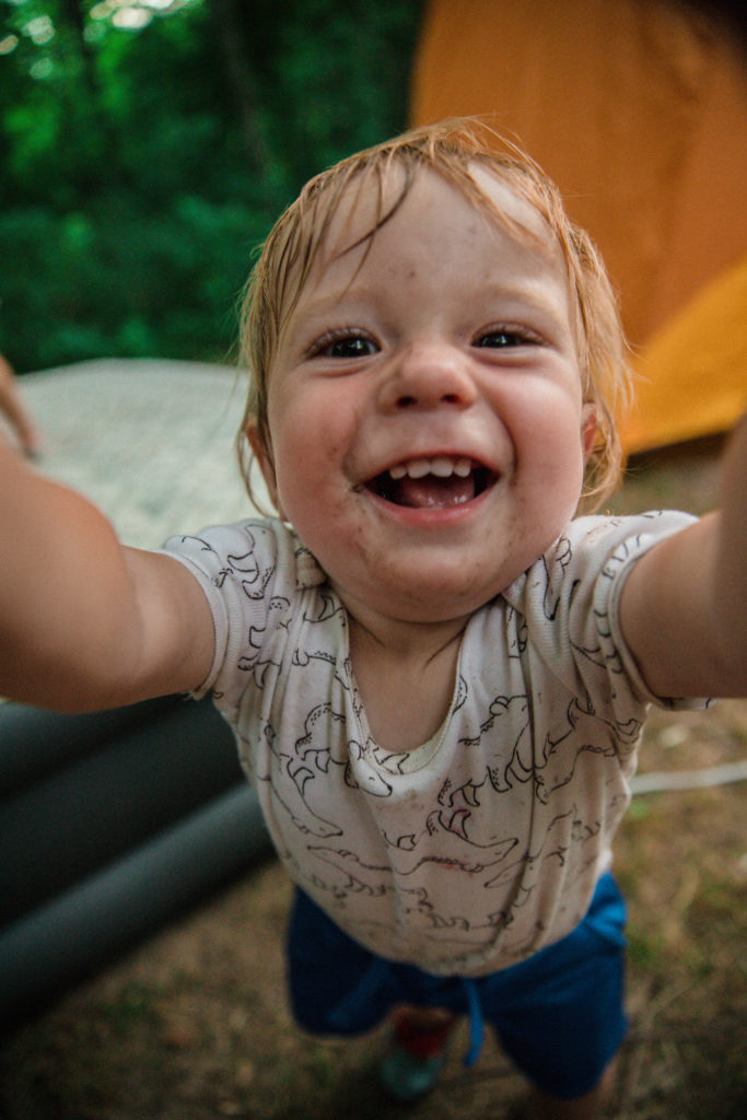 Toddler muddy face playing at tent campsite | camping with toddlers