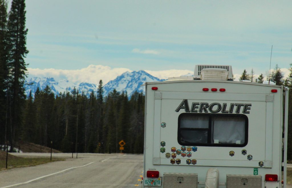 An Aerolite camper driving through the mountains