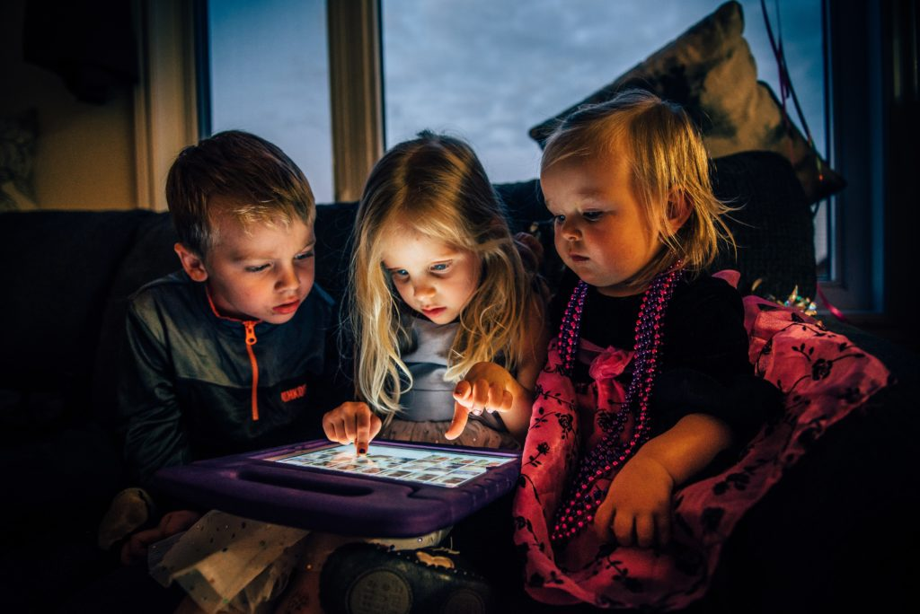 Kids playing on an ipad during a family camping trip