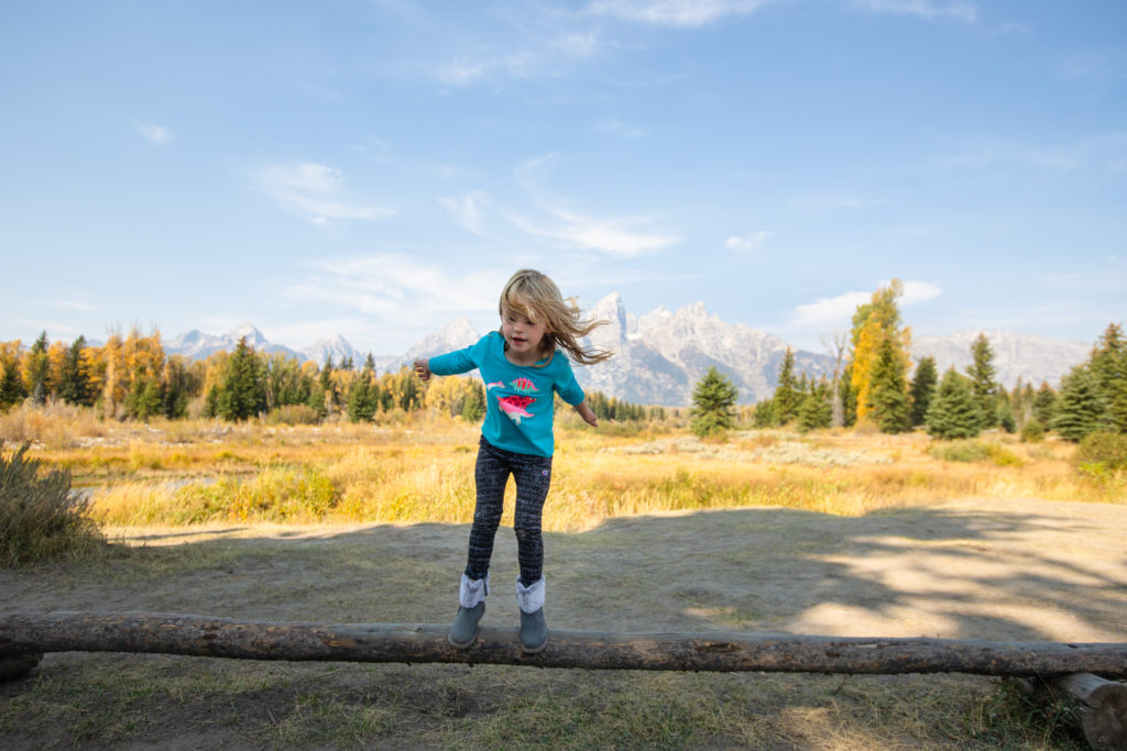 4 year old plays at Schwabacher's Landing in Grand Teton National Park