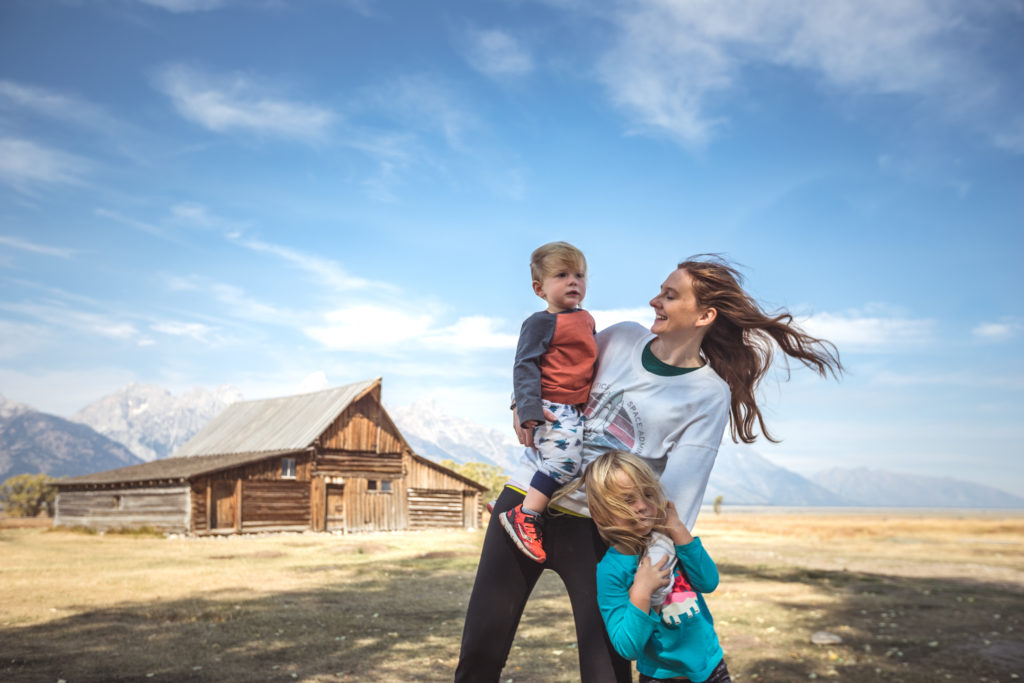 Mom and kids pose in front of the T.A. Moulton Barn on Mormon Row