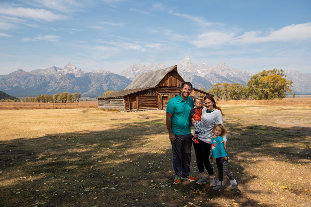 Family in front of the T.A. Moulton Barn Mormon Row | Best things to do in grand teton national park with kids