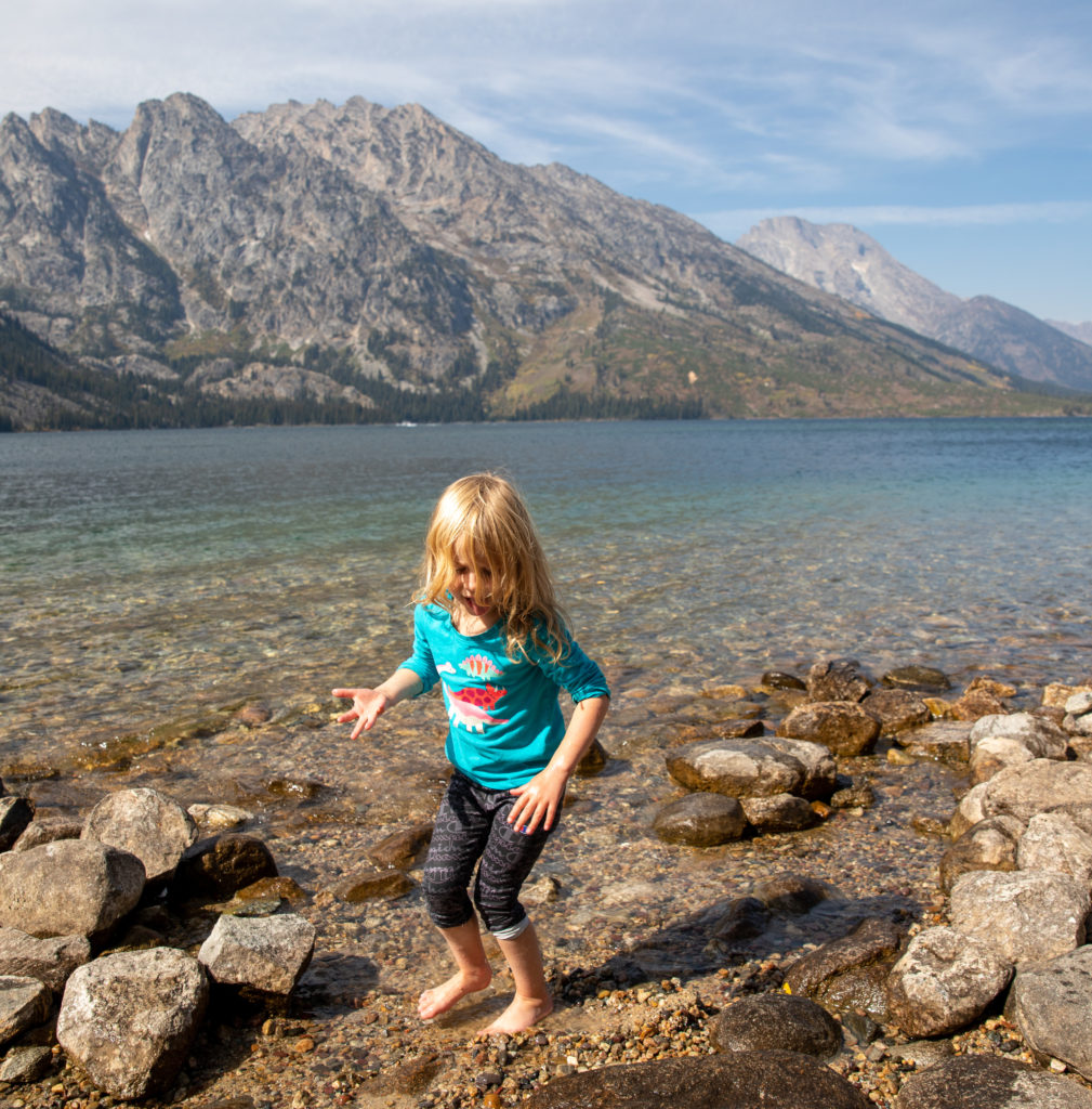 4 year old plays in the water at Jenny Lake in Grand Teton National Park
