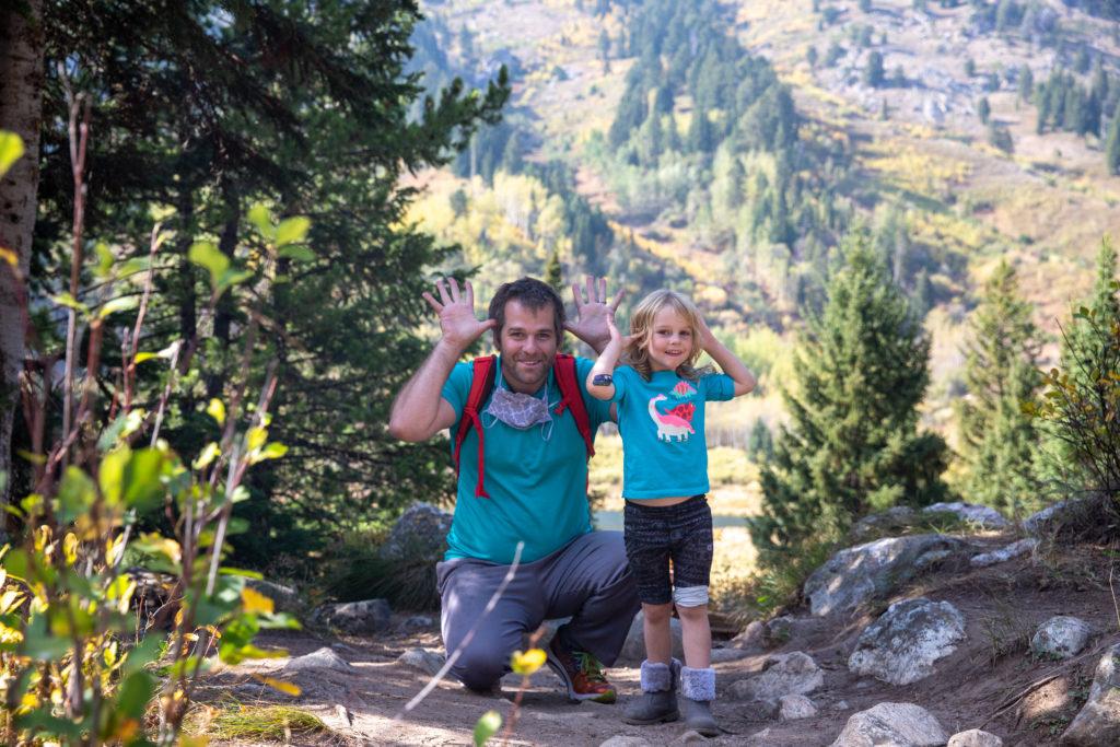 Father and daughter posing as mooses at the moose ponds trail in jenny lake