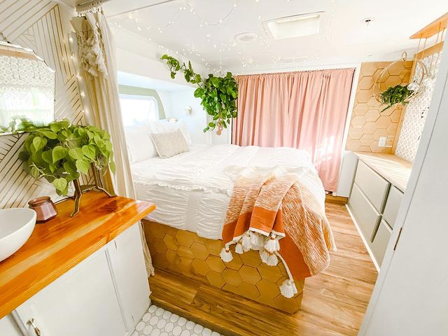 Renovated camper using curtains as a room divider