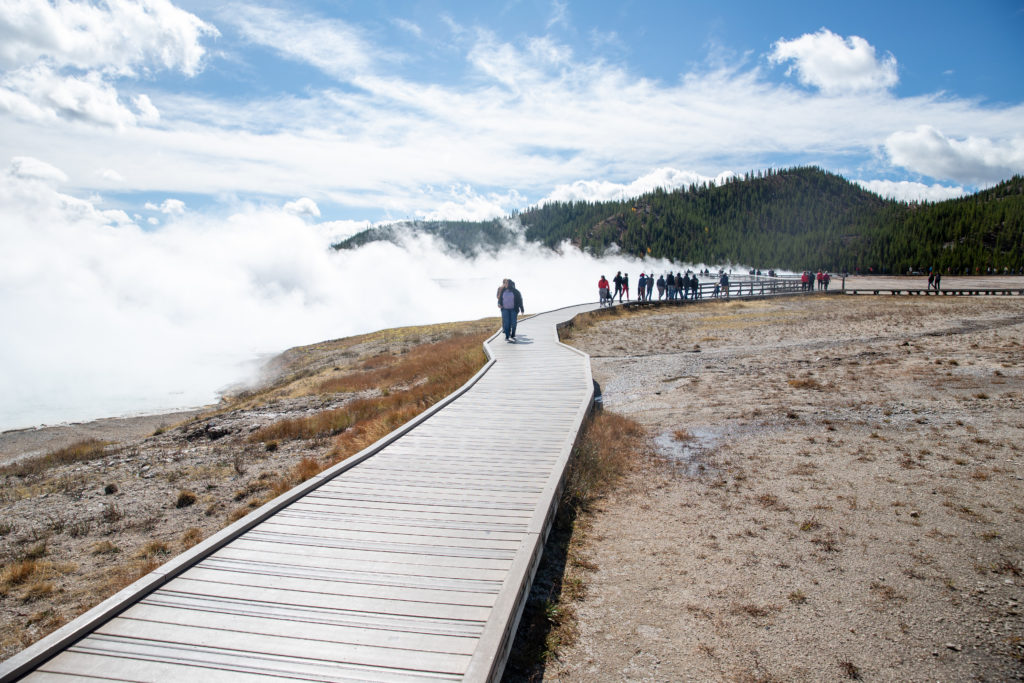 the boardwalk in the midway geyser basin | crowds in yellowstone in september